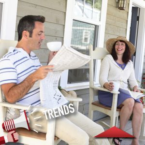 man and women sitting on front porch smiling